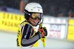 Katharina Liensberger of Austria celebrates after taking the third place at the alpine ski, women's World Cup slalom in Levi, Finland, Saturday, Nov. 21, 2020. (Jussi Nukari/Lehtikuva via AP)