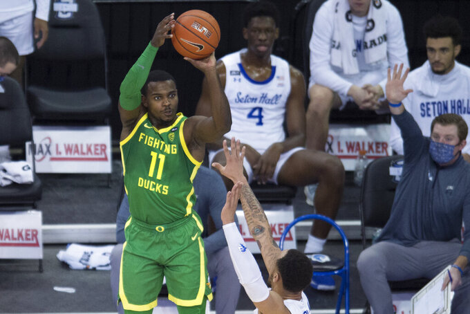 Oregon's Amauri Hardy shoots to score against Seton Hall during the first half of an NCAA college basketball game in Omaha, Neb., Friday, Dec. 4, 2020. (AP Photo/Kayla Wolf)