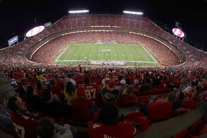 FILE - In this Aug. 24, 2019, file photo, the Kansas City Chiefs and the San Francisco 49ers play during the second half of an NFL preseason football game at Arrowhead Stadium in Kansas City, Mo. The Chiefs will open defense of their Super Bowl championship by hosting Houston on Sept. 10 in the NFL's annual kickoff game — pending developments in the coronavirus pandemic, of course. (AP Photo/Charlie Riedel, File)