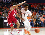 Illinois guard Trent Frazier (1) drives to the basket against Wisconsin guard D'Mitrik Trice (0) during the first half of an NCAA college basketball game in Champaign, Ill., Wednesday, Jan. 23, 2019. (AP Photo/Stephen Haas)