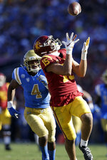 Southern California wide receiver Drake London (15) makes a catch in front of UCLA defensive back Stephan Blaylock (4) during the first half of an NCAA college football game, Saturday, Nov. 23, 2019, in Los Angeles. (AP Photo/Marcio Jose Sanchez)