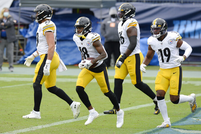 Pittsburgh Steelers wide receiver Diontae Johnson (18) runs to the sideline after scoring a touchdown against the Tennessee Titans in the first half of an NFL football game Sunday, Oct. 25, 2020, in Nashville, Tenn. (AP Photo/Mark Zaleski)