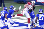 Arizona Cardinals' Dan Arnold, top, catches a pass for a touchdown during the first half of an NFL football game against the Arizona Cardinals, Sunday, Dec. 13, 2020, in East Rutherford, N.J. (AP Photo/Bill Kostroun)