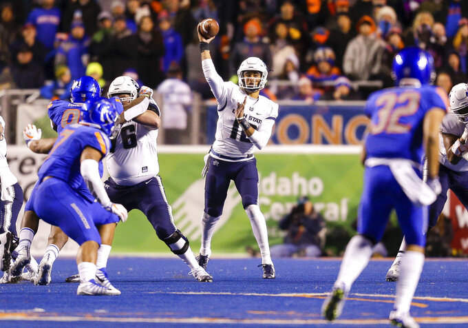 Utah State quarterback Jordan Love (10) throws a pass against Boise State during the first half of an NCAA college football game Saturday, Nov. 24, 2018, in Boise, Idaho. (AP Photo/Steve Conner)