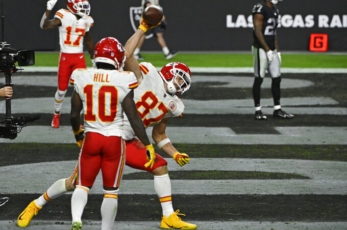Kansas City Chiefs tight end Travis Kelce (87) celebrates after scoring a touchdown against the Las Vegas Raiders during the second half of an NFL football game, Sunday, Nov. 22, 2020, in Las Vegas. (AP Photo/David Becker)