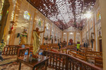 FILE - This Sunday, April 21, 2019, file photo shows the inside of St. Sebastian's Church damaged in blast in Negombo, north of Colombo, Sri Lanka. The deadly Easter attacks in Sri Lanka are a bloody echo of decades past in the South Asian island nation, when militants inspired by attacks in the Lebanese civil war helped develop the suicide bomb vest. (AP Photo/Chamila Karunarathne, File)