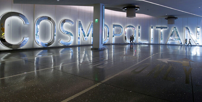FILE - This Dec. 7, 2010 file photo shows The Cosmopolitan of Las Vegas luxury resort casino and hotel. Casino giant MGM Resorts International announced Monday, Sept. 27, 2021 it will pay $1.6 billion in a 30-year agreement to acquire the operations of the Cosmopolitan Las Vegas resort on the Las Vegas Strip. (AP Photo/Isaac Brekken, File)