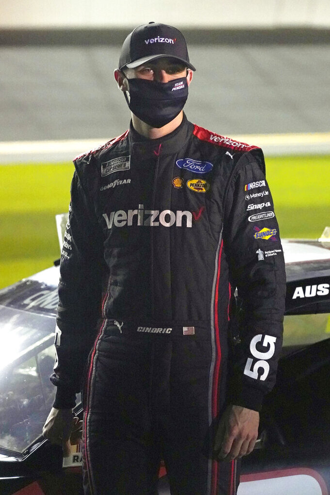 FILE- In this Wednesday, Feb. 10, 2021, file photo, Austin Cindric stands on pit road during qualifying for the NASCAR Daytona 500 auto race at Daytona International Speedway in Daytona Beach, Fla. Cindric solidified his standing at Penske by winning six races last year and his first Xfinity Series championship.  (AP Photo/John Raoux, File)