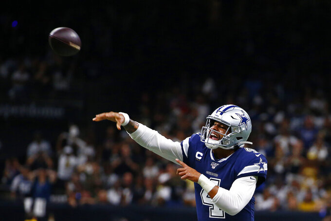 Dallas Cowboys quarterback Dak Prescott (4) passes in the first half of an NFL football game against the New Orleans Saints in New Orleans, Sunday, Sept. 29, 2019. (AP Photo/Butch Dill)