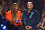 Queen Latifah, left, and John Travolta present the video of the year award at the MTV Video Music Awards at the Prudential Center on Monday, Aug. 26, 2019, in Newark, N.J. (Photo by Matt Sayles/Invision/AP)
