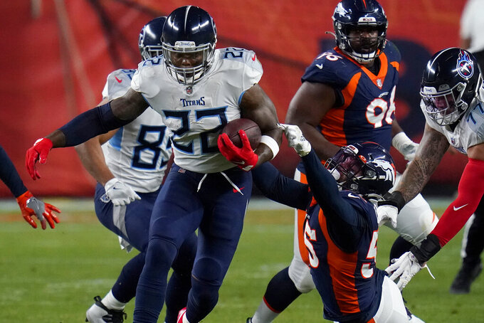 Tennessee Titans running back Derrick Henry (22) tries to elude the grasp of Denver Broncos outside linebacker Bradley Chubb (55) during the first half of an NFL football game, Monday, Sept. 14, 2020, in Denver. (AP Photo/Jack Dempsey)