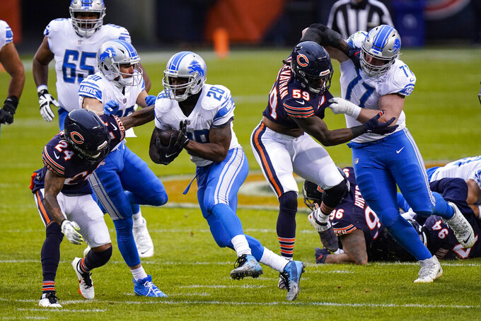 Detroit Lions running back Adrian Peterson (28) runs against the Chicago Bears in the first half of an NFL football game in Chicago, Sunday, Dec. 6, 2020. (AP Photo/Nam Y. Huh)
