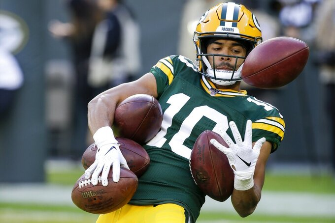 Green Bay Packers' Darrius Shepherd catches a lot of footballs before an NFL football game against the Oakland Raiders Sunday, Oct. 20, 2019, in Green Bay, Wis. (AP Photo/Mike Roemer)