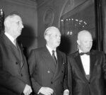 FILE - In this Tuesday, May 17, 1960 file photo, President Charles de Gaulle of France, left, Premier Harold MacMillan of Britain, center, and U.S. President Dwight D. Eisenhower leave a summit at the Elysee Palace in Paris. De Gaulle would veto Britain's application to join the then European Economic Community on two occasions that decade. Britain eventually joined in 1973 after De Gaulle's successor, Georges Pompidou, lifted France's veto. On Jan. 31, 2020, Britain is scheduled to leave what became known as the European Union. (AP Photo, File)