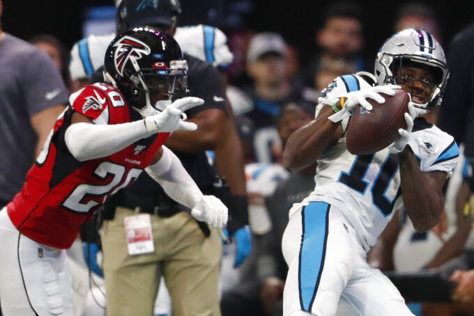 Carolina Panthers wide receiver Curtis Samuel (10) makes the catch against Atlanta Falcons defensive back Kendall Sheffield (20) during the second half of an NFL football game, Sunday, Dec. 8, 2019, in Atlanta. (AP Photo/John Bazemore)