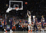 Virginia's Kyle Guy (5) shoots the last free throw to defeat Auburn 63-62 during the second half in the semifinals of the Final Four NCAA college basketball tournament, Saturday, April 6, 2019, in Minneapolis. (AP Photo/David J. Phillip)