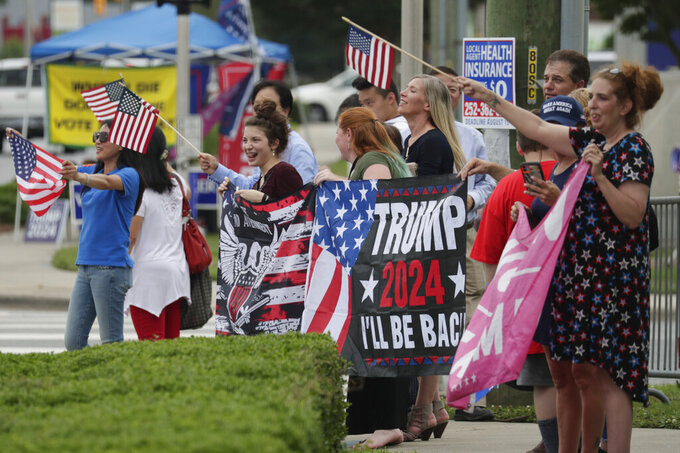 Supporters of former President Donald Trump cheer as passing motorists beep their horns in accord before he speaks at the North Carolina Republican Convention Saturday, June 5, 2021, in Greenville, N.C. (AP Photo/Chris Seward)