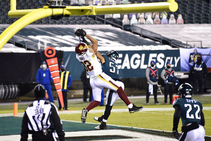 Washington Football Team's Logan Thomas (82) catches a touchdown against Philadelphia Eagles' T.J. Edwards (57) during the first half of an NFL football game, Sunday, Jan. 3, 2021, in Philadelphia. (AP Photo/Derik Hamilton)