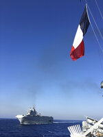 This photo provided Friday Aug.14, 2020 by the French Defense Ministry shows the French Tonnerre helicopter carrier escorted by Greek and French military vessels during a maritime exercise in the Eastern Mediterranean, Thursday, Aug. 13, 2020. Greece's prime minister warmly thanked France Thursday for boosting its military presence in the eastern Mediterranean, where Greek and Turkish warships are closely shadowing each other over a Turkish energy exploration bid in waters Athens claims as its own. (French Defense Ministry via AP)