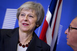 European Commission President Jean-Claude Juncker, right, greets British Prime Minister Theresa May at EU headquarters in Brussels, Wednesday, Nov. 21, 2018. British Prime Minister Theresa May meets with European Commission President Jean-Claude Juncker in a bid to finalize a Brexit agreement as she continues to battle domestic critics of the draft deal. (AP Photo/Virginia Mayo)