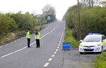 FILE - In this May 12, 2017, file photo, police officers patrol the Irish border as they wait for the European Union's chief negotiator Michel Barnier to visit the border area close to Castleblayney, Ireland. With Brexit due on Oct. 31, 2019 and a costly no-deal a possible outcome, experts still do not know, or are reluctant to say, exactly what checks are likely at the Irish border. Nevertheless, British Prime Minister Boris Johnson remains convinced that a Brexit deal can be sealed with the EU in a few weeks. (AP Photo/Peter Morrison, File)