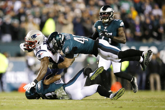 New England Patriots' Benjamin Watson (84) is tackled by Philadelphia Eagles' Nate Gerry (47) and Rodney McLeod (23) during the first half of an NFL football game, Sunday, Nov. 17, 2019, in Philadelphia. (AP Photo/Michael Perez)