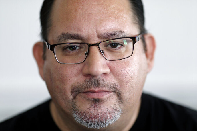 Jacob Olivas, 50, a survivor of priest abuse, poses for a portrait at home on Sunday, Sept. 29, 2019 in Rancho Cucamonga, Calif. Olivas was abused by a priest for a year when he was between the ages of 6 and 7. Still, more than four decades later, his life is difficult. (AP Photo/Wong Maye-E)