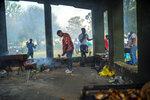 People celebrate South Africa's Heritage Day by cooking a barbecue at Zoo Lake park in Johannesburg Thursday Sept. 24, 2020. As the number of worldwide Covid-19 death is nearing the million mark, coronavirus related case numbers and deaths in South Africa hit the lowest in months. (AP Photo/Jerome Delay)