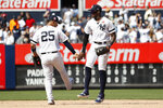 New York Yankees left fielder Cameron Maybin celebrates with second baseman Gleyber Torres (25) after defeating the San Diego Padres, Monday, May 27, 2019, in New York. (AP Photo/Michael Owens)