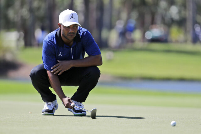 Harris English lines up a putt on the eighth hole during the first round of the Honda Classic golf tournament, Thursday, Feb. 27, 2020, in Palm Beach Gardens, Fla. (AP Photo/Lynne Sladky)