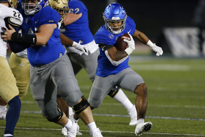 Buffalo running back Ron Cook Jr. (2) carries the ball during the second half of an NCAA college football game against Akron in Amherst, N.Y., Saturday, Dec. 12, 2020. (AP Photo/Jeffrey T. Barnes)