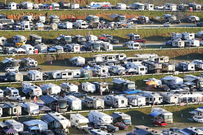 Fans camp outside Bristol Motor Speedway before a NASCAR Xfinity Series auto race Friday, Sept. 17, 2021, in Bristol, Tenn. (AP Photo/Mark Humphrey)