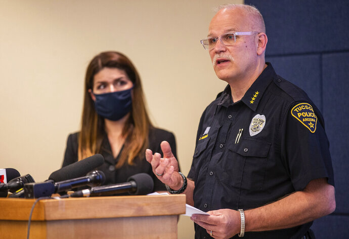 Tucson Police Chief Chris Magnus, right, speaks as Mayor Regina Romero listens during a press conference, Wednesday, June 24, 2020, in Tucson, Ariz.  Chief Magnus offered his resignation after the death of a 27-year-old man who died while handcuffed and placed face-down, resulting in the resignation of three officers the chief said had violated department policy. The city council and city manager have to approve resignation. The city council and city manager have to approve resignation. The medical examiner's office didn't determine a manner of death but said Carlos Ingram-Lopez had died of sudden cardiac arrest while intoxicated by cocaine and physically restrained.  (Josh Galemore/Arizona Daily Star via AP)