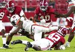 Alabama linebackers Christopher Allen (4) and Jaylen Moody (42) stop Auburn running back Mark-Antony Richards (28) during an NCAA college football game Saturday, Nov. 28, 2020, in Tuscaloosa, Ala. (Mickey Welsh/The Montgomery Advertiser via AP)