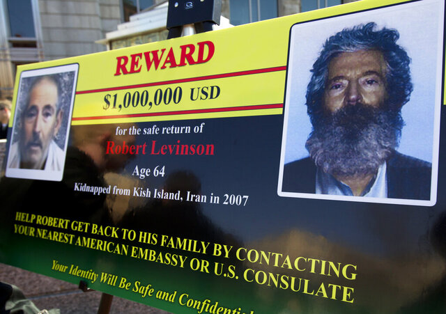 FILE - In this March 6, 2012 file photo, an FBI poster showing a composite image of former FBI agent Robert Levinson, right, of how he would look like now, left, taken from the video, released by his captors in Washington during a news conference. The family of retired FBI agent Levinson said Wednesday, March 25, 2020, that U.S. government officials have concluded that he has died while in the custody of Iran. (AP Photo/Manuel Balce Ceneta, File)