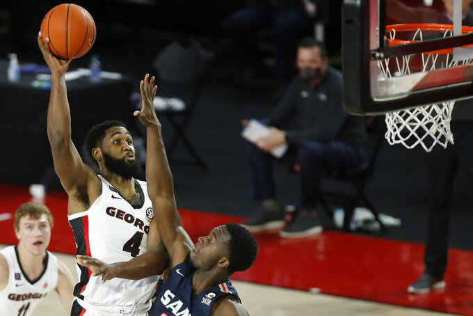 Georgia's Andrew Garcia (4) shoots over Samford forward Stanley Henderson Jr. during an NCAA college basketball game in Athens, Ga., Saturday, Dec. 12, 2020. (Joshua L. Jones/Athens Banner-Herald via AP)