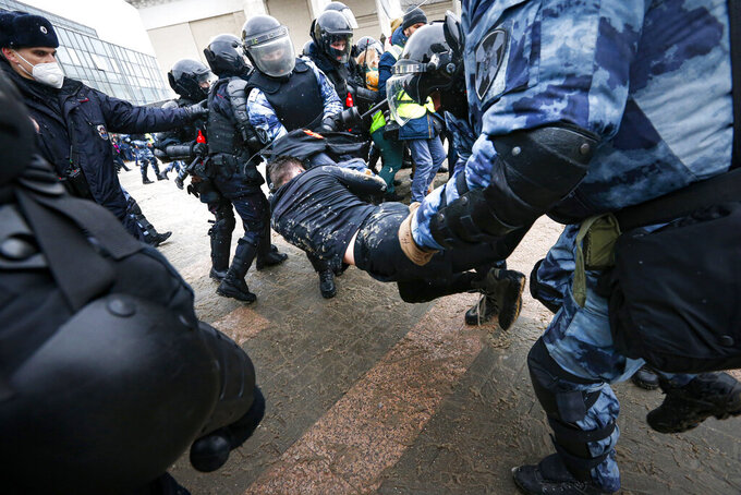 FILE - In this Sunday, Jan. 31, 2021, police officers detain a man during a protest against the jailing of opposition leader Alexei Navalny in Moscow, Russia. Unprecedented nationwide protests have rocked Russia for two weekends in a row, with tens of thousands rallying in support of opposition leader Alexei Navalny. Detainees are recounting their miserable experiences as Moscow jails were overwhelmed following mass arrests from protests in support of opposition leader Alexei Navalny this week. (AP Photo/Alexander Zemlianichenko, File)