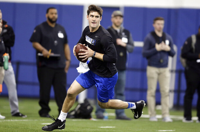 Quarterback Daniel Jones rolls out to pass during Duke's football Pro Day in Durham, N.C., Tuesday, March 26, 2019. (AP Photo/Gerry Broome)