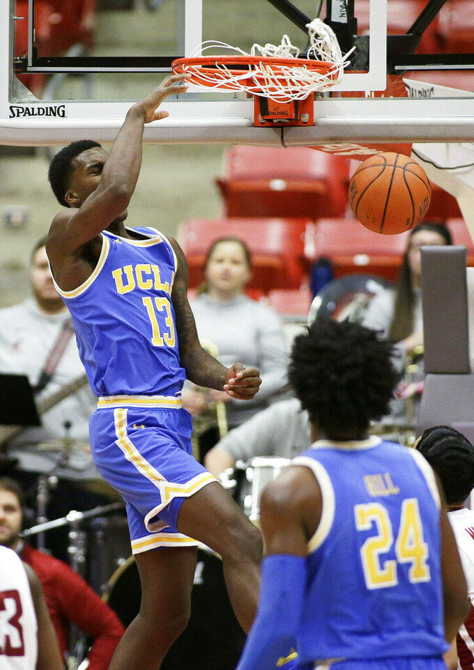 UCLA guard Kris Wilkes (13) dunks during the second half of an NCAA college basketball game against Washington State in Pullman, Wash., Wednesday, Jan. 30, 2019. UCLA won 87-67. (AP Photo/Young Kwak)