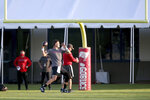 Tampa Bay Buccaneers quarterback Tom Brady (12) throws a pass during NFL football training camp, Tuesday, Aug. 4, 2020, in Tampa. (Douglas R. Clifford/Tampa Bay Times via AP)