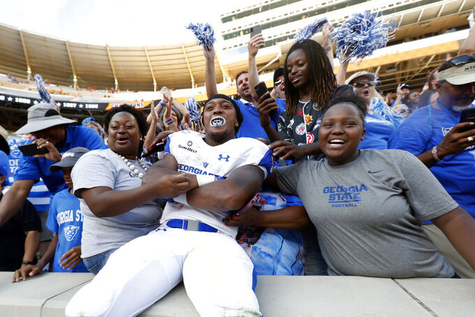 Georgia State cornerback Bryquice Brown (5) celebrates with fans after a win over Tennessee in an NCAA college football game Saturday, Aug. 31, 2019, in Knoxville, Tenn. (AP Photo/Wade Payne)