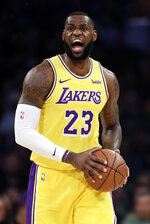 Los Angeles Lakers' LeBron James yells during the first half of the team's NBA basketball game against the Houston Rockets on Thursday, Feb. 21, 2019, in Los Angeles. (AP Photo/Marcio Jose Sanchez)