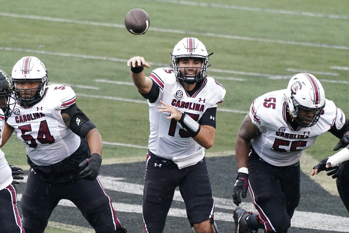 South Carolina quarterback Collin Hill (15) passes against Vanderbilt in the first half of an NCAA college football game Saturday, Oct. 10, 2020, in Nashville, Tenn. (AP Photo/Mark Humphrey)