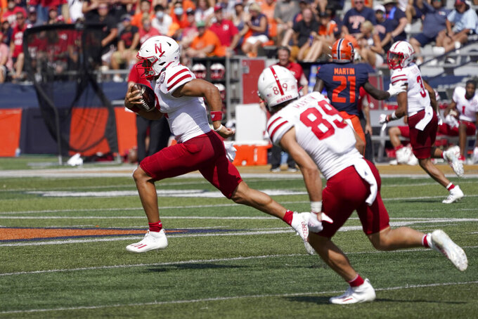 Nebraska quarterback Adrian Martinez runs for a 75-yard touchdown during the second half of an NCAA college football game against Illinois Saturday, Aug. 28, 2021, in Champaign, Ill. Illinois won 30-22. (AP Photo/Charles Rex Arbogast)