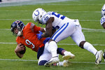 Chicago Bears quarterback Nick Foles (9) is tackled by Indianapolis Colts' Bobby Okereke (58) during the first half of an NFL football game, Sunday, Oct. 4, 2020, in Chicago. (AP Photo/Charles Rex Arbogast)