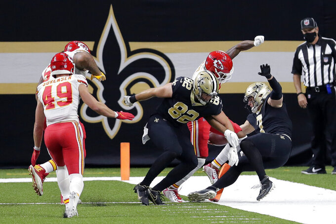 New Orleans Saints quarterback Taysom Hill (7) just misses scoring a touchdown in the first half of an NFL football game against the Kansas City Chiefs in New Orleans, Sunday, Dec. 20, 2020. (AP Photo/Brett Duke)