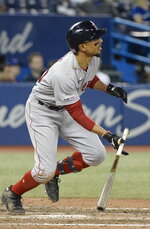 Boston Red Sox's Mookie Betts watches his home run against the Toronto Blue Jays during the 12th inning of a baseball game Wednesday, May 22, 2019, in Toronto. (Nathan Denette/The Canadian Press via AP)