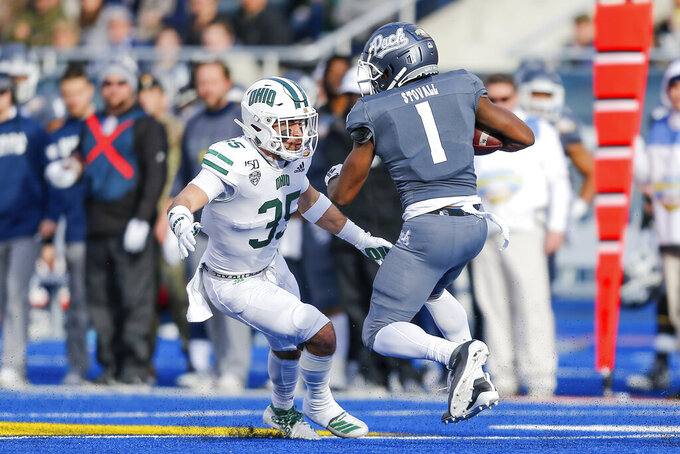 Ohio linebacker Dylan Conner (35) attempts to tackle Nevada wide receiver Melquan Stovall (1) in the first half of the Famous Idaho Potato Bowl NCAA college football game Friday, Jan. 3, 2020, in Boise, Idaho. (AP Photo/Steve Conner)