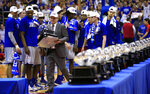 FILE - Kansas coach Bill Self carries his 13th Big 12 championship trophy following the team's NCAA college basketball game against TCU in Lawrence, Kan., in this Feb. 22, 2017, file photo. Bill Self acknowledged this is a new feeling for him. In nearly two decades at Kansas, he has never been out of the hunt for the Big 12 title before the calendar flipped to February. (AP Photo/Orlin Wagner, File)