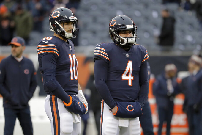 Chicago Bears quarterbacks Mitchell Trubisky (10) and Chase Daniel (4) warm up before an NFL wild-card playoff football game against the Philadelphia Eagles Sunday, Jan. 6, 2019, in Chicago. (AP Photo/Nam Y. Huh)